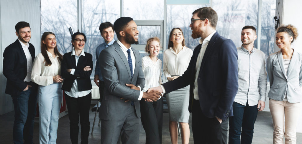 CEO manager congratulating successful worker after meeting with staff, two men shaking hands